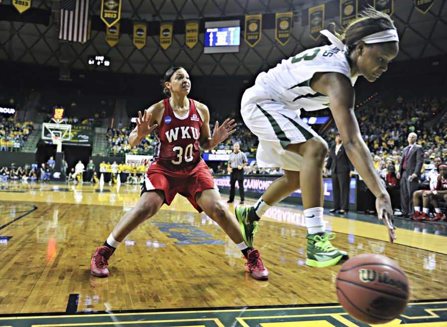Baylor freshman forward Nina Davis tries to save the ball from going out of bounds while WKU junior forward Chastity Gooch steps back during the first round of the 2014 NCAA Divison I Women's Basketball Championship at the Ferrell Center in Waco, Texas on Saturday March 22, 2014. (Jeff Brown/HERALD)
