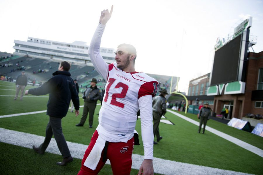 Redshirt senior quarterback Brandon Doughty signals upward following WKUs 67-66 overtime win over No. 19 Marshall in Huntington, West Virginia. Doughty threw for 491 yards and eight touchdowns to five different receivers in the upset victory. The Hilltoppers win spoiled the Thundering Herds bid for an undefeated season. Nick Wagner/HERALD
