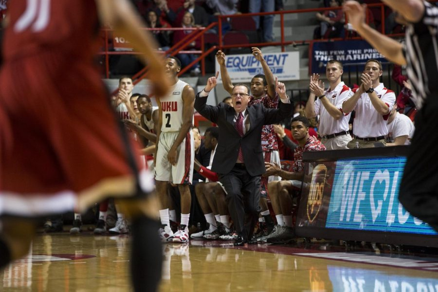 Head Coach Ray Harper and the WKU bench reacts after a successful three-point basket during the first half of WKUs Nov. 15 game against Austin Peay. The Hilltoppers defeated the Governors 77-70 in their opening game of the season. Brandon Carter/HERALD