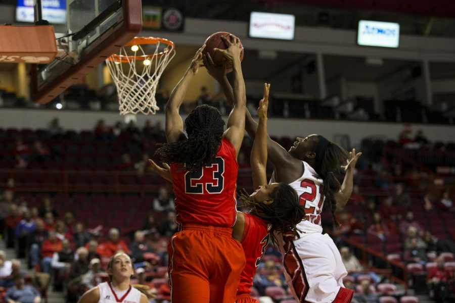 Senior guard Alexis Govan jumps for a rebound against two Ole Miss defenders during the second half of WKUs game against Ole Miss on Dec. 4. Govan led all scorers with 22 points as the Lady Toppers defeated the Rebels 98-69. Brandon Carter/HERALD