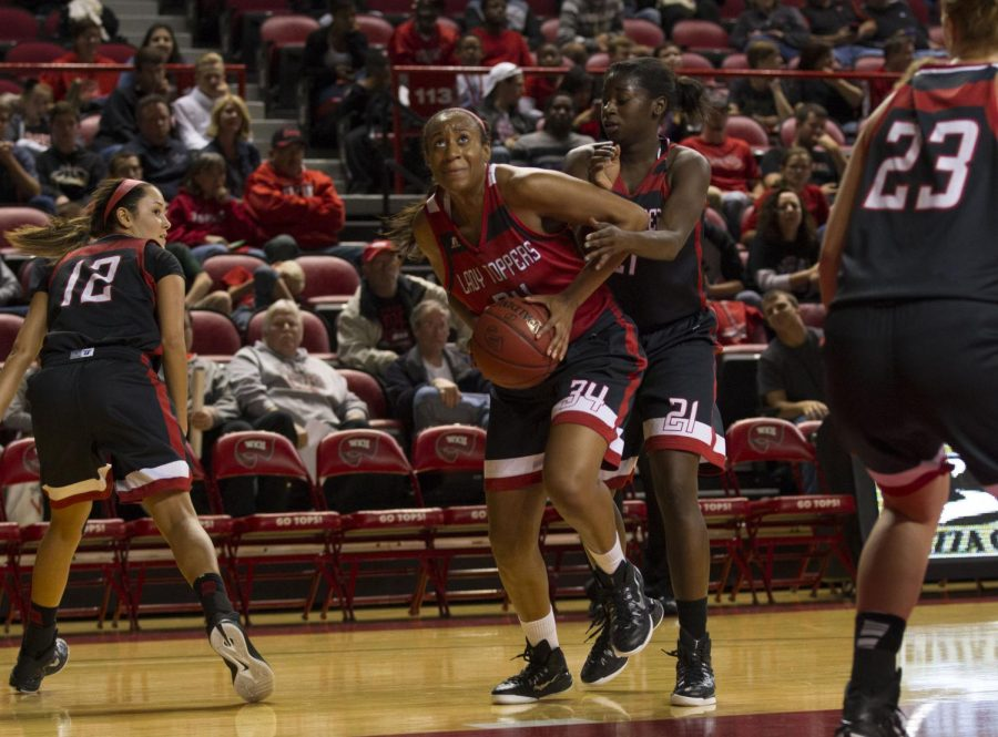 Freshman+forward+Jaiveonna+Norris+%2834%29+drives+the+ball+past+senior+guard+Alexis+Govan+%2821%29+in+the+women%27s+team+scrimmage+during+Hilltopper+Hysteria+on+Oct.+18+at+Diddle+Arena.+The+Red+Team+defeated+the+Black+Team+44-29+in+the+scrimmage.+Brandon+Carter%2FHERALD