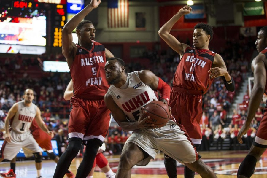 Senior guard T.J. Price (52) drives past Austin Peays Chris Horton (5) and Khalil Davis (11) during the second half of WKUs Nov. 15 game against the Governors. Price led all scorers with 22 points and was a perfect 4-4 from three-point range as WKU defeated APSU 77-70. Brandon Carter/HERALD