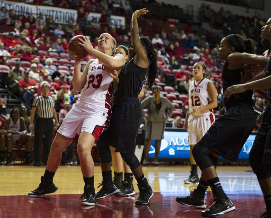 Freshman+guard+Ivy+Brown+%2823%29+battles+a+Central+Arkansas+defender+under+the+net+during+the+second+half+of+WKU%27s+Nov.+14+game+against+the+Sugar+Bears.+Brown+notched+three+points+and+four+rebounds+as+the+Lady+Toppers+defeated+UAC+93-57.+Nick+Wagner%2FHERALD