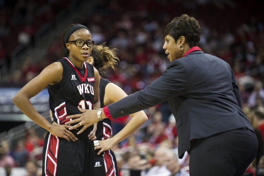Head+Coach+Michelle+Clark-Heard+converses+with+Tashia+Brown+during+a+timeout+in+the+Lady+Topper%27s+game+against+the+University+of+Louisville+at+the+Yum%21+Center%2C+November+25%2C+2014.+Justin+Gilliland%2FHERALD