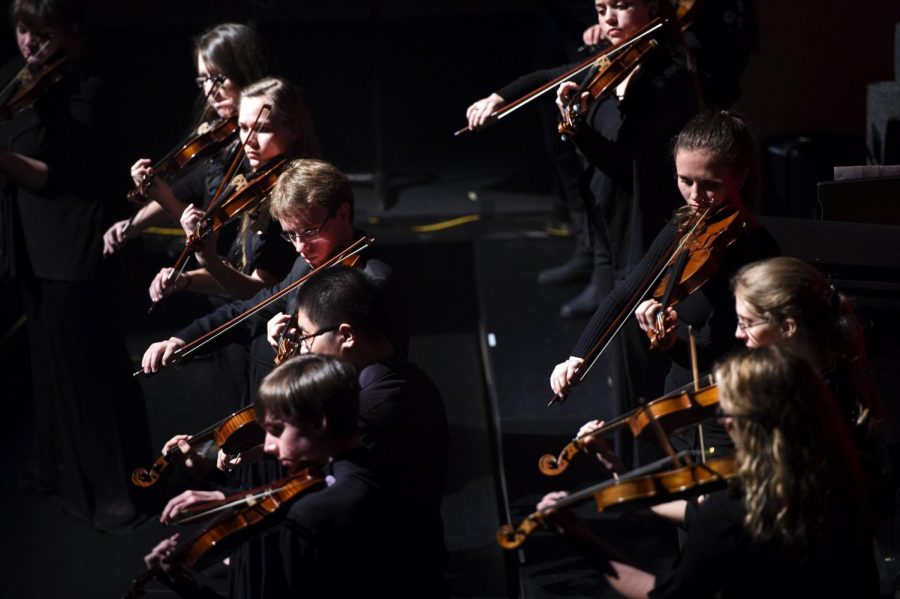 The WKU violins perform during the PRISM Concert at Western Kentucky University's Van Meter Hall on Friday, Jan. 23.