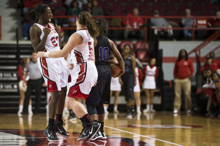Senior guard Alexis Govan (21) and junior guard Micah Jones (5) celebrate after forcing a turnover during the first half of WKU's Nov. 14 game against Central Arkansas. The Lady Toppers forced 22 turnovers in their 93-57 victory over the Sugar Bears. Brandon Carter/HERALD