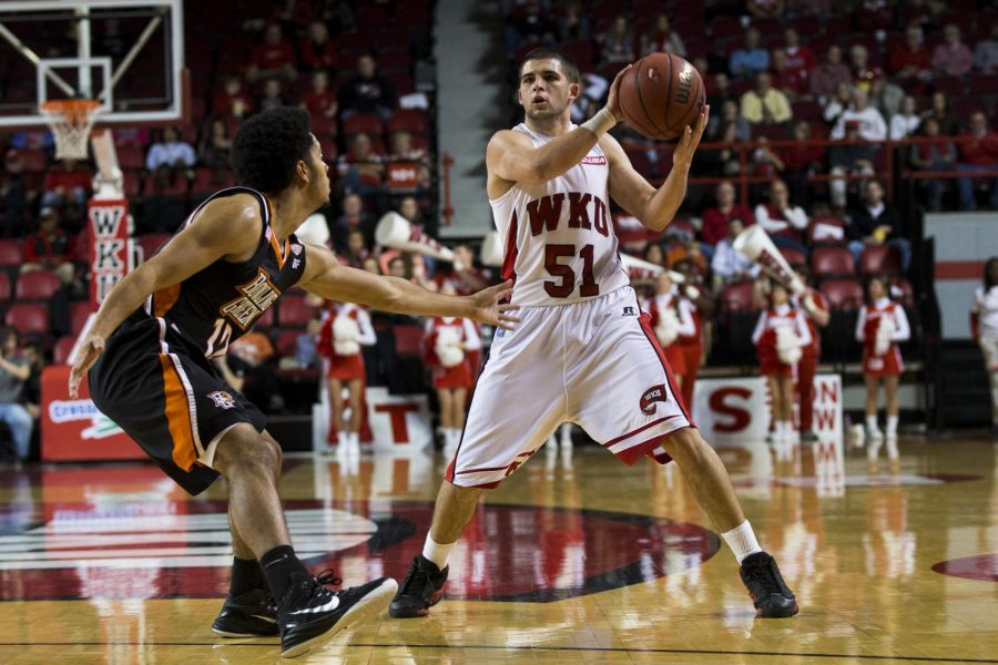 Redshirt+sophomore+guard+Chris+Harrison-Docks+looks+to+pass+the+ball+inside+during+the+first+half+of+WKUs+game+against+Bowling+Green+State+on+Dec.+3.+Harrison-Docks+scored+seven+points+and+dished+three+assists+in+WKUs+62-52+victory+over+the+Falcons.+Brandon+Carter%2FHERALD
