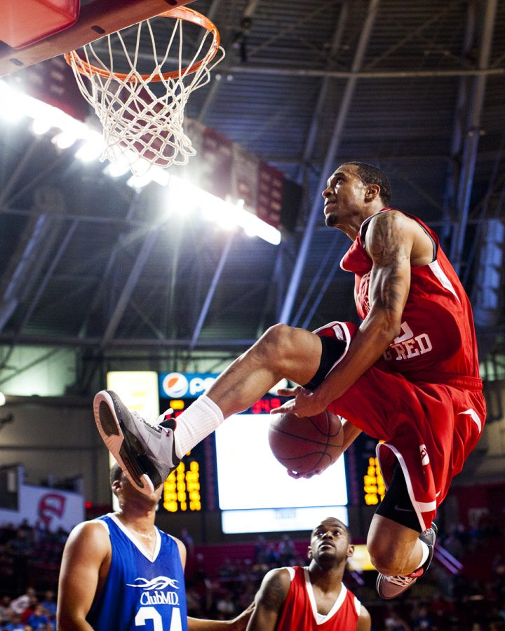 WKU alum guard Courtney Lee makes an between-the-legs dunk late in the Big Red vs. Big Blue alumni in Diddle Arena on Tuesday night. The red team defeated the blue team 112-97.