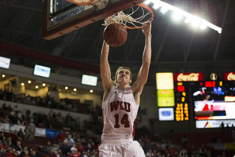 Sophomore forward Ben Lawson slams the ball home during the final minute of WKUs game against Bowling Green State on Dec. 3. Lawson scored 12 points and was a perfect 4-4 from the free-throw line as the Hilltoppers defeated the Falcons 62-52. Brandon Carter/HERALD