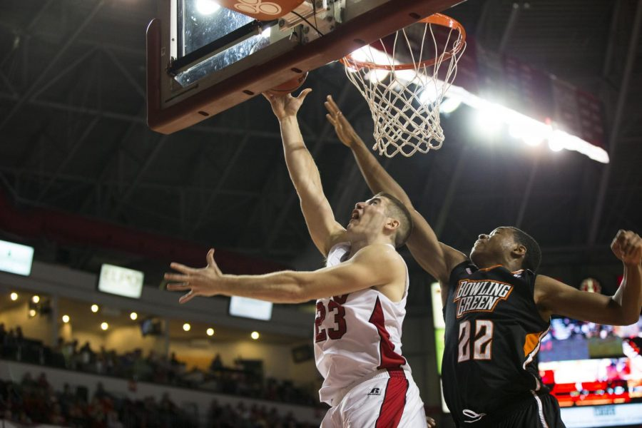 Freshman forward Justin Johnson (23) goes for a layup against Bowling Green States Richaun Holmes (22) during WKUs game against the Falcons on Dec. 3. Johnson totaled seven points, three rebounds, and two blocks in 20 minutes of action in the Hilltoppers 62-52 victory. Brandon Carter/HERALD