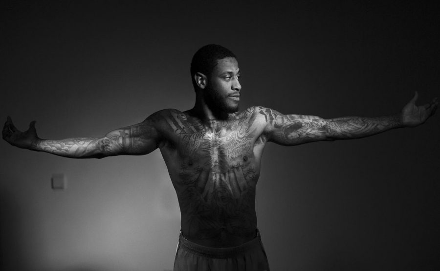 """Senior Hilltopper basketball guard, Trency Jackson (3), of Jackson, Miss., received his first tattoo, a detailed half sleeve, that showcases an angel, when he was 16-years-old. """"I thought it was going to hurt but it didn't,"""" Jackson said. He instantly fell in love with inking his body and hasn't considered stopping. At a young age, Jackson knew he wanted to have a multitude of tattoos because of his brother. Jackson doesn't know how many tattoos he has but is positive they outnumber the ink on other players of the team. Most of the ink on Jackson's body represents his Catholic faith but a portrait of his mother and his older brother, two important people in his life, also frame sides of his arms. At the moment, Jackson only has the front of his body covered but, not for long. """"I'm not sure what it will be yet… but [the tattoo on my back] will be big,"""" Jackson said. Alyssa Pointer/HERALD"""
