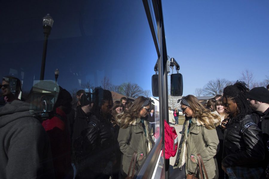 A large group of WKU students board the Red Line bus just outside of Mass Media and Technology Hall, on Feb. 3. During peak ride times, in between classes, spots can be hard to come by on Topper Transit buses. Luke Franke/HERALD