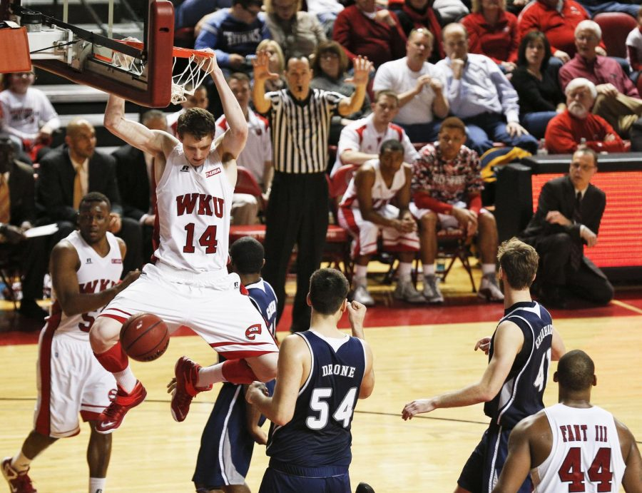WKU sophomore forward Ben Lawson slams the ball home against Conference USA opponent Rice Feb. 7, 2015 at E.A. Diddle Arena. The Hilltoppers would go on to lose to the Owls 72-68 in only their third home loss of the season. (Luke Franke/Herald)