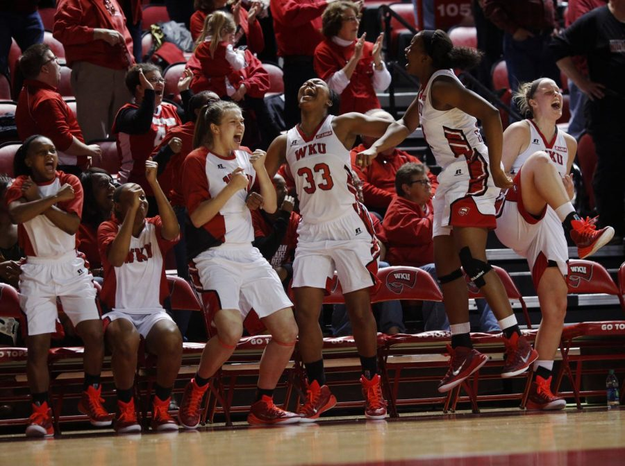 WKU+players+jump+off+the+bench+in+celebration+after+their+team+stopped+MTSU+from+scoring+during+the+final+seconds+of+regulation.+Sealing+the+win+for+the+Lady+Toppers.+WKU+would+go+on+to+defeat+conference+rival+MTSU+in+a+game+that+went+down+to+the+final+buzzer+by+a+score+of+63-60.+Placing+them+at+the+top+of+the+current+Conference+USA+standings.+%28Luke+Franke%2FHerald%29
