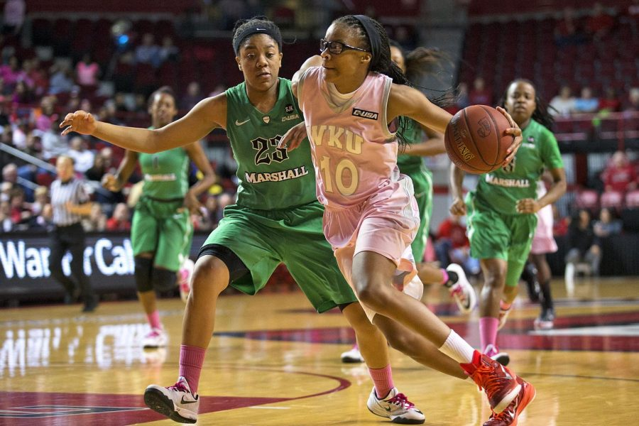 WKU Freshman forward Tashia Brown drives toward the basket during WKU's game against Marshall at Diddle Arena on January 4, 2015. The lady toppers won with a final score of 67-53. Mike Clark/HERALD
