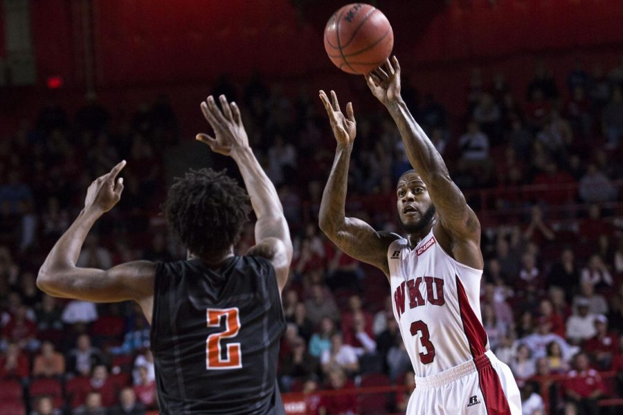 WKU senior guard, Trency Jackson (3) shoots a three-point shot in the face of UTEPs Omega Harris (2) during the two teams hotly contested overtime matchup Thursday, Jan. 22 at Diddle Arena. Jackson led the HIlltoppers in scoring with 14 points and led the team to a 71-66 victory in overtime. Luke Franke/HERALD