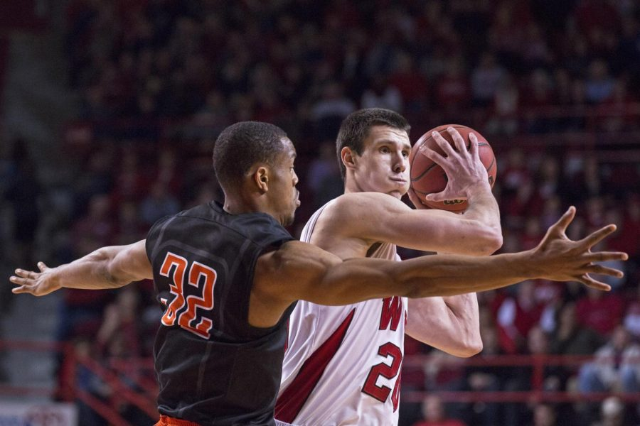 Junior forward Aleksej Rostov keeps the ball away from UTEPs Vince Hunter (32) during the teams matchup at Diddle Arena Thursday, Jan. 22. WKU would go on to win an overtime thriller 71-66 to remain undefeated in conference play. Luke Franke/HERALD