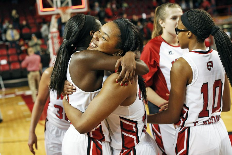 WKU teammates Alexis Govan and Jalynn McClain share an embrace after defeating Conference USA opponent MTSU by a score of 63-60. Placing them at the top of the current Conference USA standings. (Luke Franke/Herald)