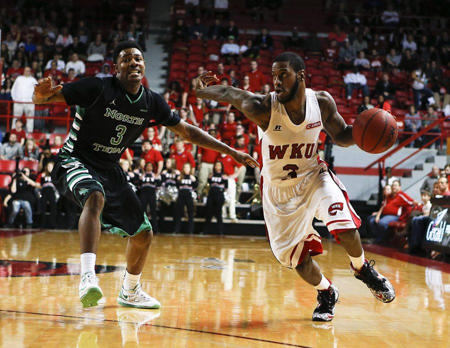 Western Kentucky University senior Trency Jackson drives past North Texas sophomore DeAndre Harris during WKUs victory against North Texas on Thursday Feb. 5, 2015. Photo by Harrison Hill/ WKU HERALD