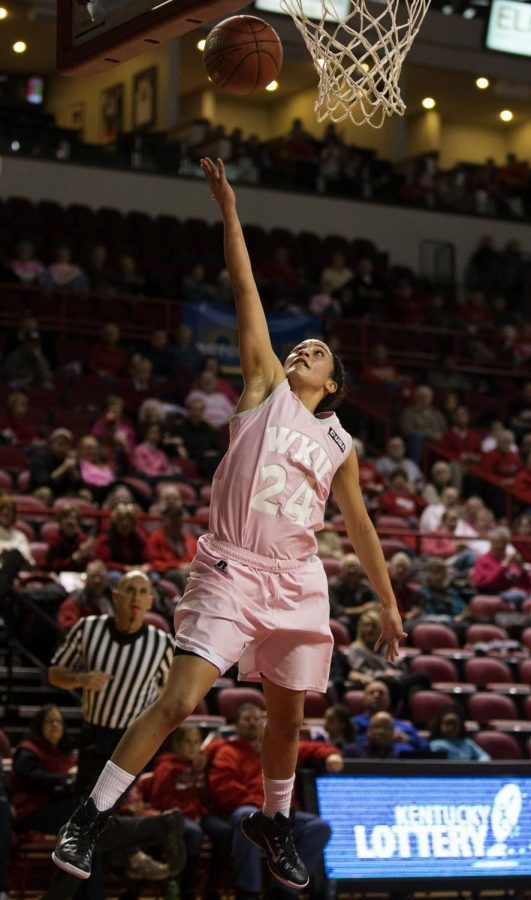 WKU's senior guard Ileana Johnson makes a layup after a turnover and breakaway during the Lady Topper's 74-60 win over Marshall, Saturday, Feb. 14, 2015, at E.A. Diddle Arena in Bowling Green, Ky. Johnson contributed three steals and a block to the Lady Topper's win which moves their record to 21-4.
