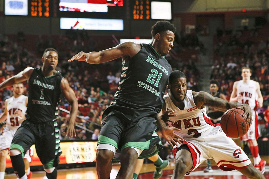 WKU guard and rising Senior Trency Jackson drives to the basket against North Texas guard T.J. Taylor on Feb 5, 2015 in Bowling Green, Kentucky. WKU beat North Texas 65-59. Harrison Hill/HERALD