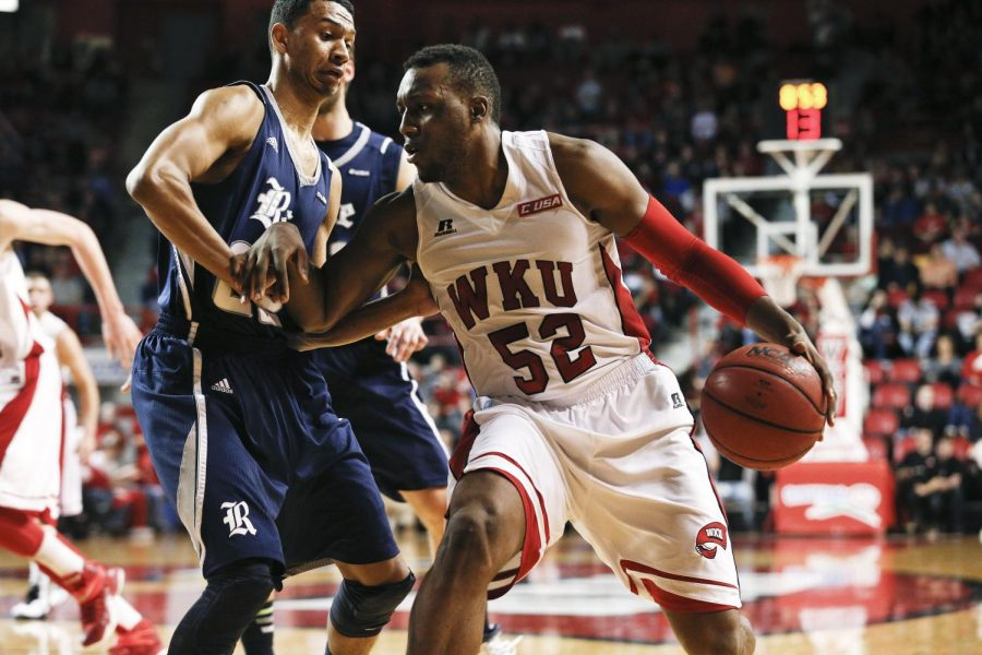 WKU senior guard T.J. Price dribbles to the lane against Conference USA opponent Rice Feb. 7, 2015 at E.A. Diddle Arena. The Hilltoppers would go on to lose to the Owls 72-68 in only their third home loss of the season. (Luke Franke/Herald)