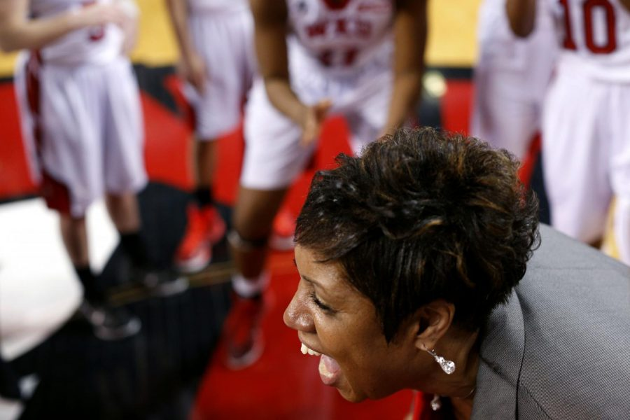 WKU+head+basketball+coach+Michelle+Clark-Heard+celebrates+with+her+team+after+defeating+Conference+USA+opponent+MTSU+by+a+score+of+63-60+Saturday+Feb.+21+in+E.A.+Diddle+Arena.+The+win+put+the+Lady+Toppers+atop+the+Conference+USA+standings.+Luke+Franke%2FHerald