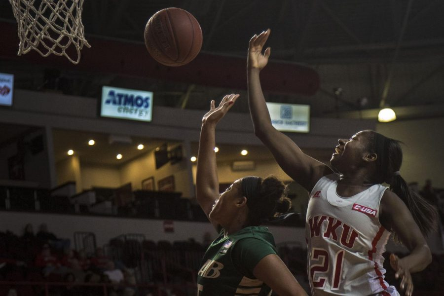 Senior guard Alexis Govan attempts a rebound against University of Alabama at Birmingham senior forward Janae Smith (25) at Diddle Arena on February 19, 2015. WKU would go on to win the game 59-51, in their fourth straight win in a row. Nicole Boliaux/HERALD