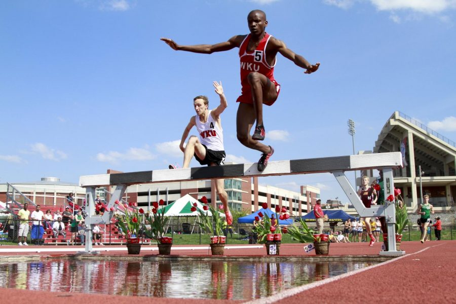 WKU junior Aaron Stevens (left) and freshman Peter Agaba compete in the men's 3000 meter Steeplechase Saturday at the Hilltopper Relays. The two finished third and second respectively behind Marshall freshman William Shaffer. Photo by Luke Franke/HERALD