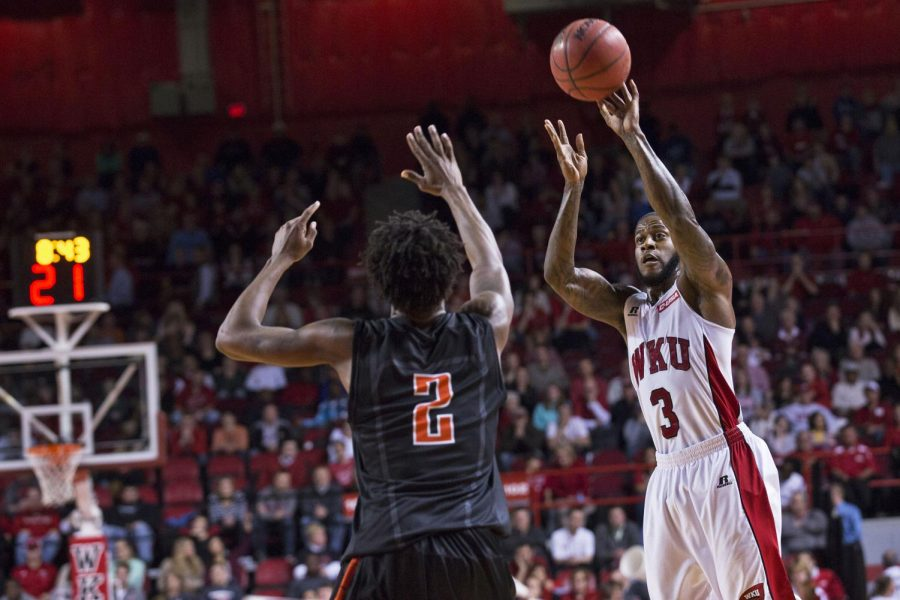 Senior guard Trency Jackson (3) shoots a three-point shot in the face of UTEP's Omega Harris (2), during overtime, on Thursday, Jan. 22, in Diddle Arena. Jackson led the Hilltoppers in scoring with 14 points and led the team to a 71-66 victory in overtime. Luke Franke/HERALD