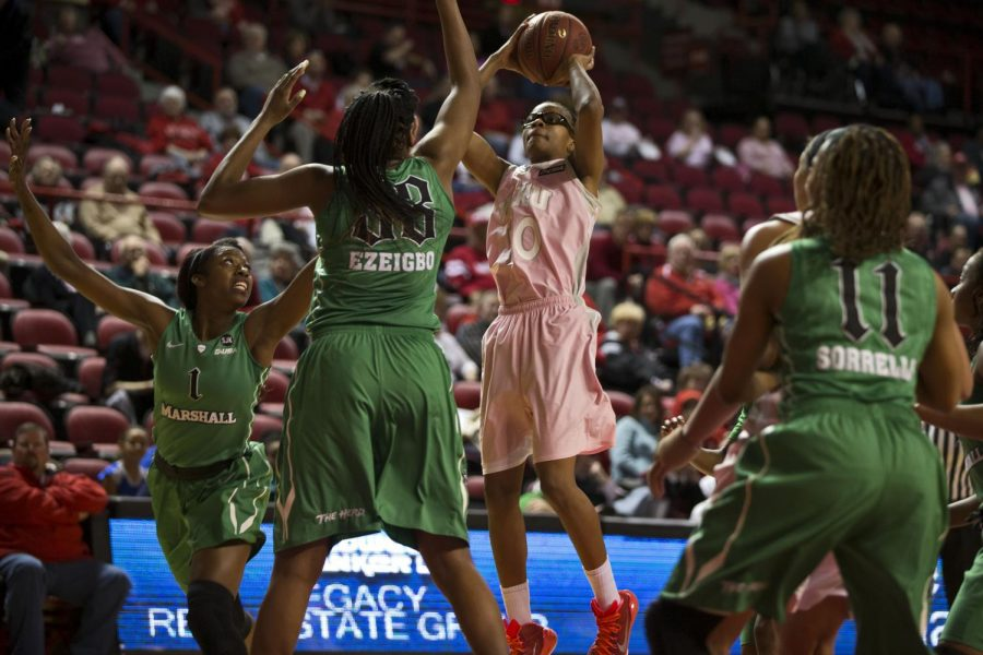 WKU's freshman guard Tashia Brown (10) shoots over Marshall's center Chukwuka Ezeigbo (33) during the Lady Topper's 74-60 win over Marshall, Saturday, Feb. 14, 2015, at E.A. Diddle Arena in Bowling Green, Ky. Brown was one of four Lady Topper's who contributed at least 10 points in the win, which improves WKU's record to 21-4.