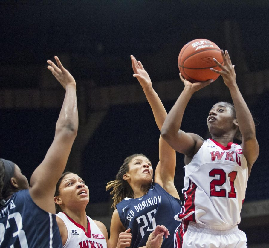WKU senior guard Alexis Govan (21) shoots a contested jumper during the team's Conference USA tournament semifinal matchup against Old Dominion University Friday March 13, 2015 at Legacy Arena in Birmingham, Ala. Despite leading by 22 points early in the first half the game became closely contested in the final seconds. WKU would go on to win 61-52 and advance to the Championship game tomorrow Saturday March 14 against Southern Mississippi University. Luke Franke/HERALD