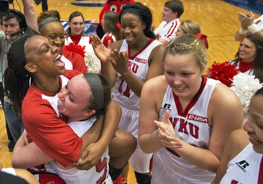 WKU%27s+sophomore+guard+Keirra+Muhammad+%2814%29+jumps+on+junior+guard+Micah+Jones+%285%29+after+the+Lady+Topper%27s+60-57+win+over+Southern+Miss+in+the+championship+game+of+the+Conference+USA+tournament+Saturday%2C+March+14%2C+2015%2C+at+Legacy+Arena+in+Birmingham%2C+Ala.+The+Lady+Toppers+secured+an+automatic+berth+in+the+NCAA+tournament+with+the+win.+Mike+Clark%2FHERALD