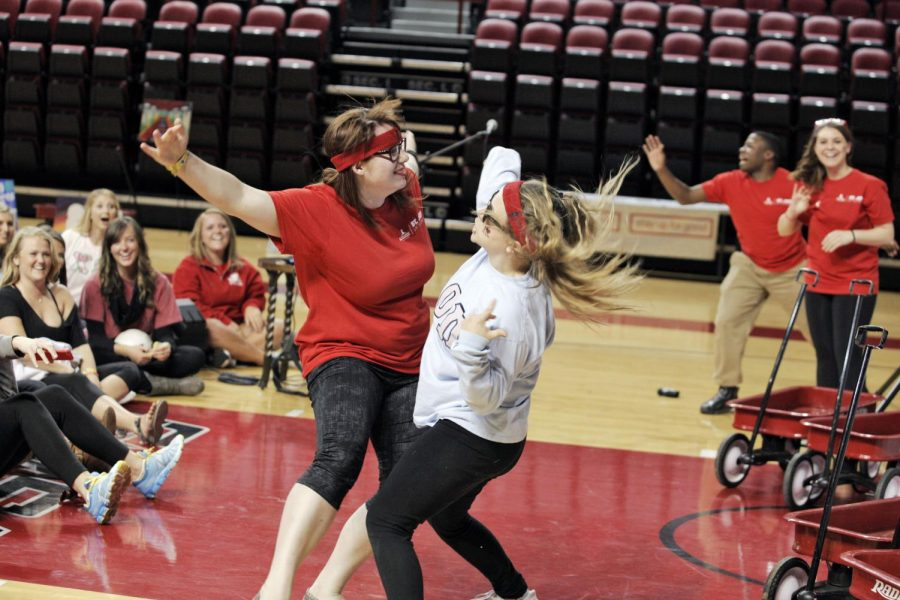 Hannah Diehl, a sophomore from Louisville, and Kathleen Baker, a senior from Glasgow, battle in a dance off as a way to stay up all night during Up 'til Dawn event at E.A. Diddle Arena on Friday night. The event was dedicated to the children of St. Jude Children's Research Hospital. Ashley Copper/HERALD