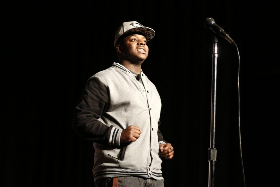Members of Iota Phi Theta, Ernest Simmons (not pictured) and Ihyauszz Cole,19, speak at Love the Way You Lie in the Downing Student Union auditorium at WKU on March 24, 2015. Cole is a sophomore at WKU and is majoring in psychology.