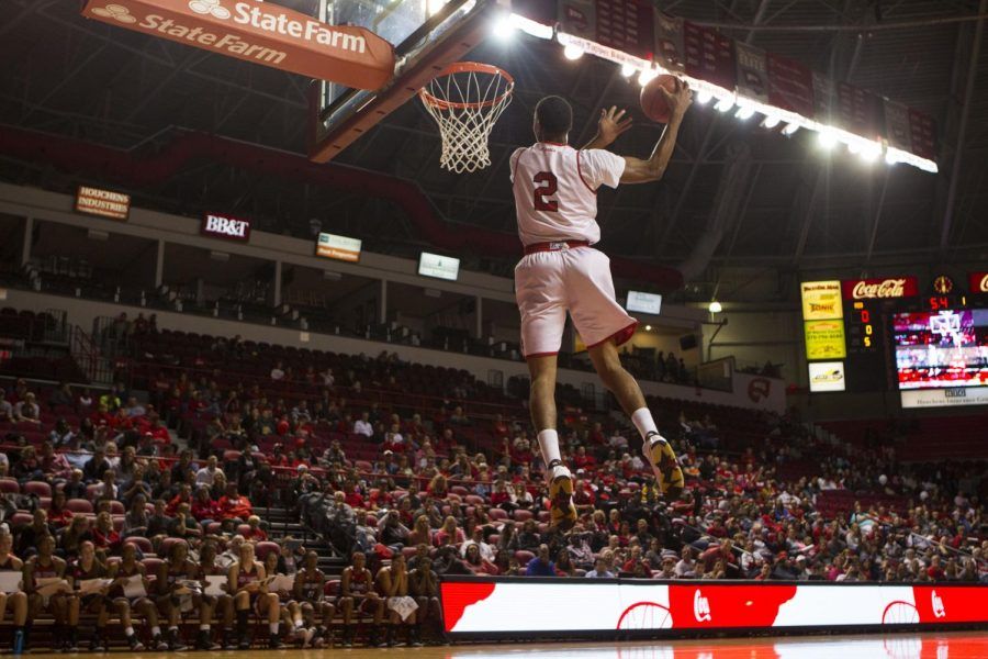 Freshman guard DJ Clayton dunks during the slam dunk contest at Hilltopper Hysteria on Oct. 18 at Diddle Arena. The event featured player introductions for both the mens and womens basketball teams, scrimmages, a three-point contest and a slam dunk contest. Brandon Carter/HERALD