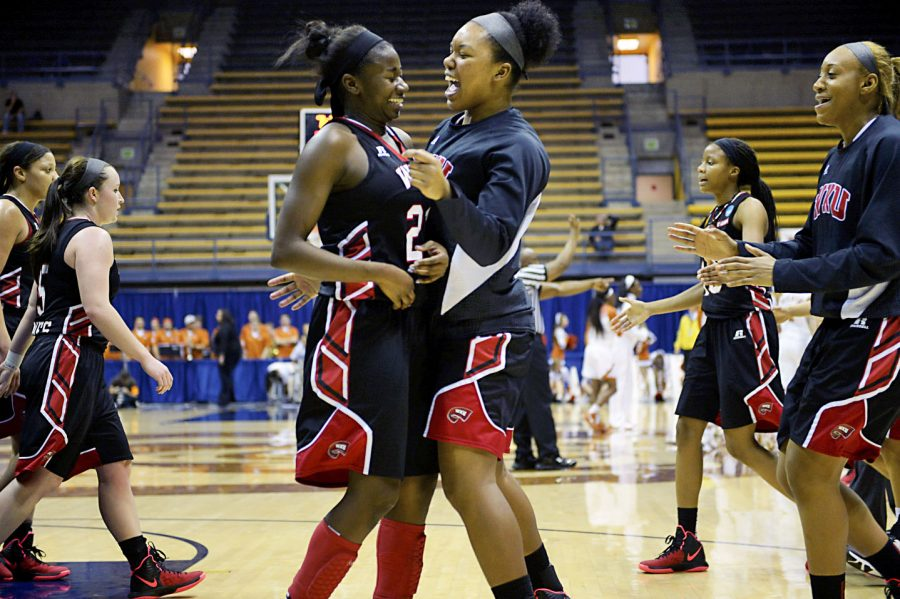 Lady+Topper+senior+senior+guard%2C+Alexis+Govan+%2821%29+is+congratulated+by+forward%2C+Jaylnn+McClain+%2833%29%2C+after+scoring+three+points+during+the+NCAA+Division+I+Women%27s+Basketball+Championship+at+Haas+Pavilion+in+Berkley%2C+California%2C+Friday%2C+March+20%2C+2015.+Govan+scored+20+points+during+the+game.+Jeffery+Brown%2FHERALD%C2%A0