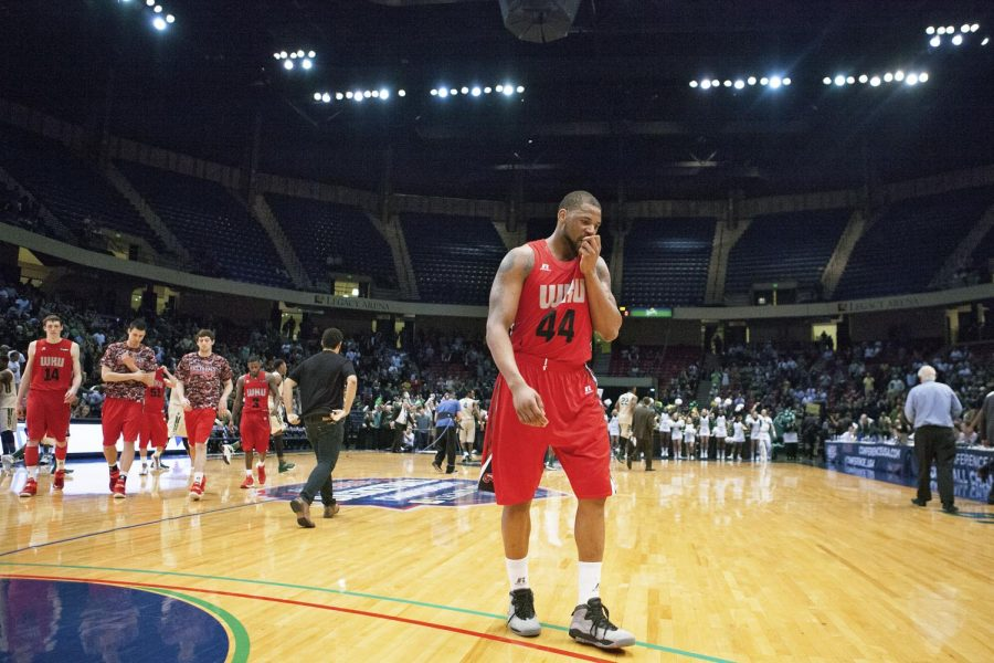 WKUs senior forward George Fant (44) walks off the court after his final game as a Hilltopper, a 52-53 loss against the University of Alabama at Birmingham in the second round of the Conference USA tournament Thursday, March 12, 2015, at Legacy Arena in Birmingham, Ala. Fant led the Toppers with 18 points but they fell short in the final minute. Mike Clark/HERALD