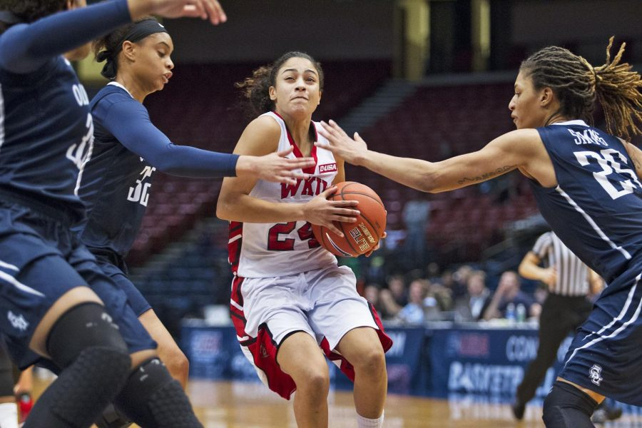 WKU senior guard Ileana Johnson (24) drives against several Old Dominion defenders during the team's Conference USA tournament semifinal matchup against Old Dominion University Friday March 13, 2015 at Legacy Arena in Birmingham, Ala. Despite leading by 22 points early in the first half the game became closely contested in the final seconds. WKU would go on to win 61-52 and advance to the Championship game tomorrow Saturday March 14 against Southern Mississippi University. Luke Franke/HERALD