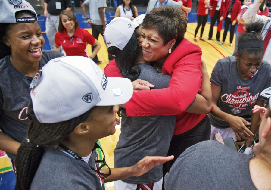 WKU Women's Head Coach Michelle Clark-Heard celebrates with her team minutes after the team's championship victory against Southern Miss. in the Conference USA tournament championship Friday March 14, 2015 at Legacy Arena in Birmingham, Ala. The victory clinched a NCAA tournament spot for the Lady Toppers and vaulted their record to 30-4. Luke Franke/HERALD