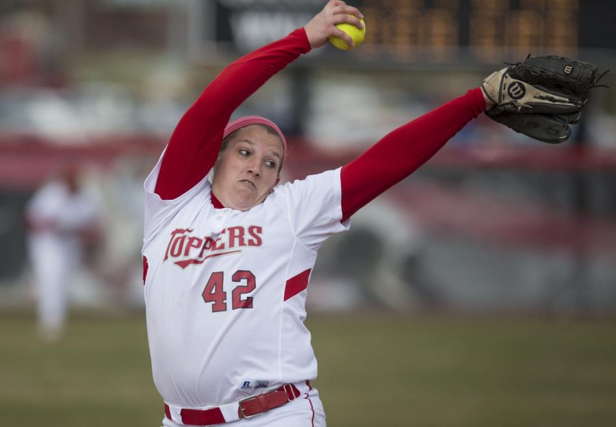 Senior pitcher Emily Rousseau pitches during the first game of a double-header with University of Louisville on March 19, 2014. (Luke Franke/HERALD)