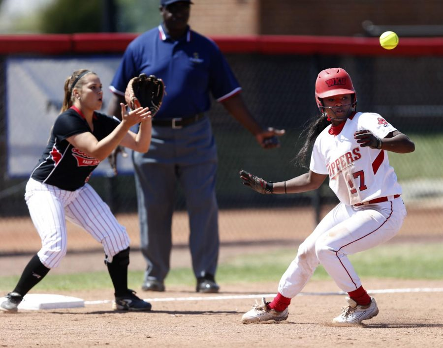 Caught+in+a+pickle%2C+senior+infielder+Olivia+Watkins+changes+directions+to+avoid+being+tagged+by+Louisiana-Lafayette+sophomore+third+basemen+Samantha+Walsh+on+Saturday.+The+Cajuns+bested+WKU+8-4%2C+and+proceeded+to+sweep+the+weekend%27s+matches+against+the+Lady+Toppers%2C+who+had+until+then+been+undefeated+in+conference+play.+%28Ian+Maule%2FHERALD%29