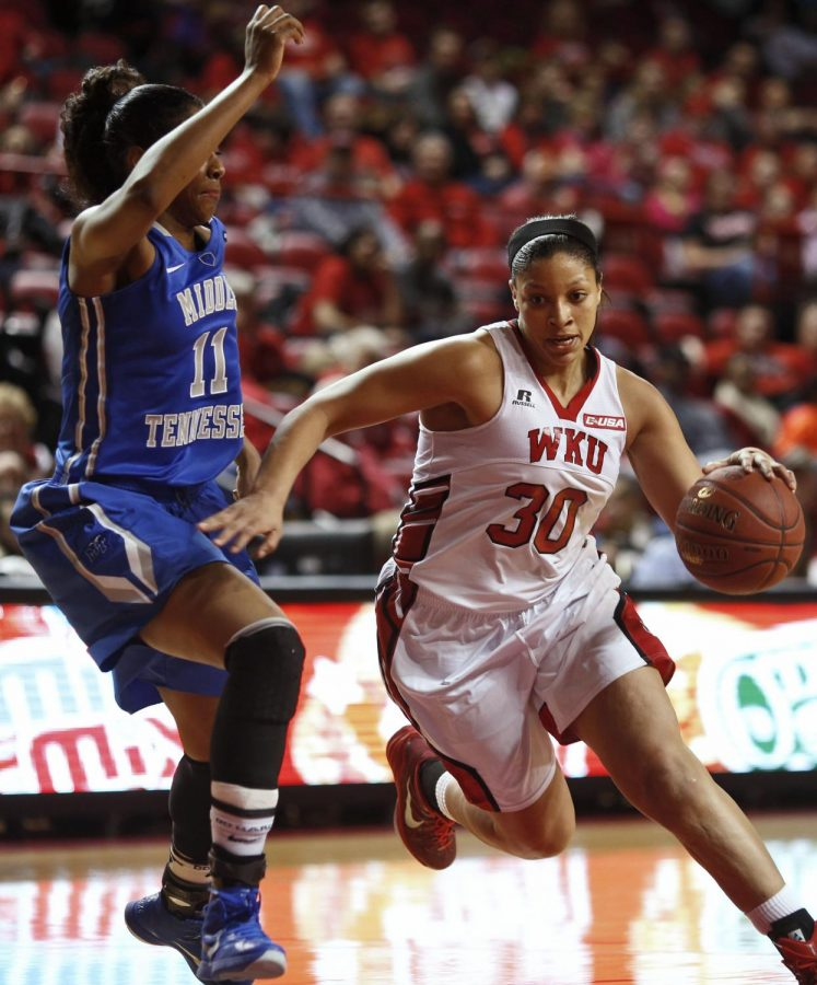 WKU senior forward Chastity Gooch (30) drives the lane against a MTSU defender Saturday Feb. 21 in the two teams' Conference USA matchup. WKU would go on to defeat conference rival MTSU in a game that went down to the final buzzer by a score of 63-60. (Luke Franke/Herald)