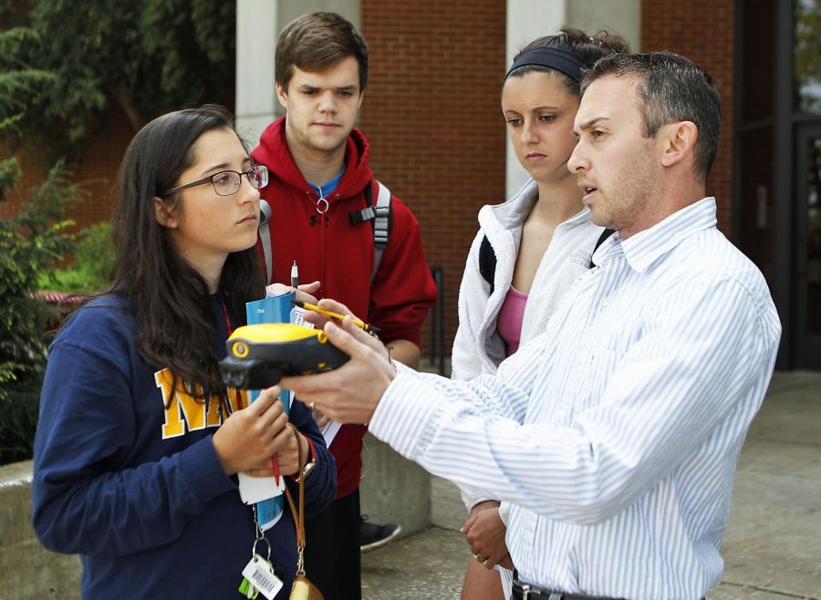 Elizabeth Cason from Owensboro, Andrew Gibbs from Bowling Green and Taylor Fry from Cynthiana learn how to navigate around campus using the Trimble device. David Siskin a mapping and GIS specialist from Louisville teach the WKU students how to use the device. Students navigate around campus using clues and the device to find the exact location. After finding the location they receive a raffle ticket in hope to win a prize. GIS Science Club hosts Geo Cache in the EST building on Tuesday April 21, 2015. ASHLEY COOPER/HERALD
