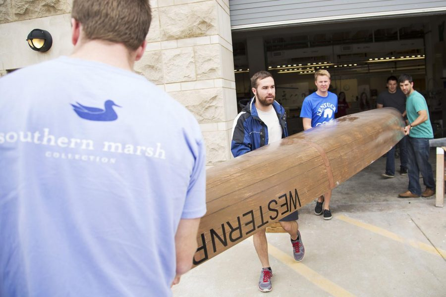 Members of the WKU Concrete Canoe team carry their team's canoe, which weighs roughly 160 pounds, outside of the EBS building Monday to be put on display. The team qualified for nationals after placing first overall at the 2015 Ohio Valley Student Conference March 25-28. Luke Franke/Herald