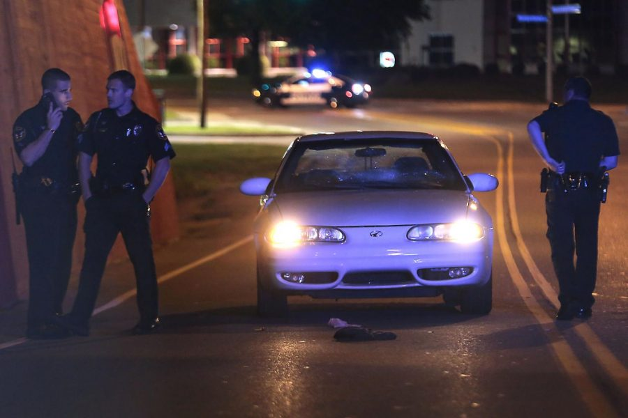 Bowling Green Police examine belongings scattered by a Shawntrice Hammonds who was hit by a car on Russellville Road. The accident occurred around 10 p.m. on Sunday beneath the train overpass. Hammonds was flown toTriStar Skyline Medical Center, according to a BGPD report.