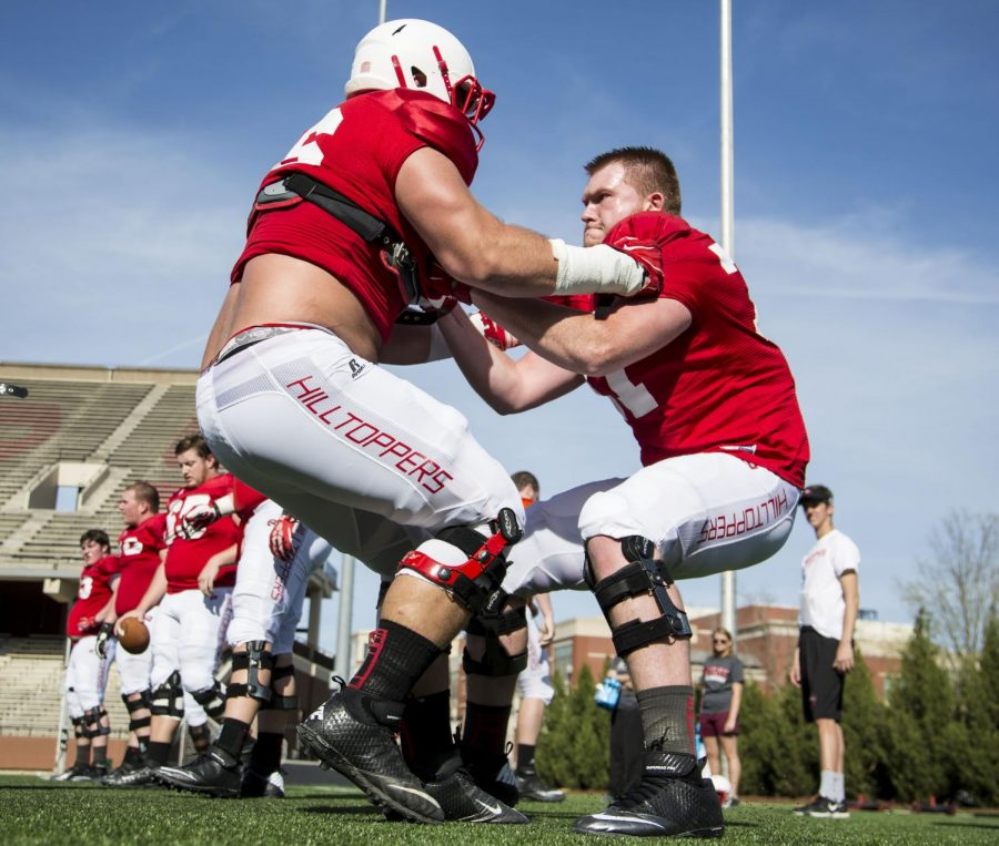 WKU freshman offensive lineman R.J. Scaife (71, right) goes head to head with another WKU offensive lineman during the teams open practice Wednesday April 1, 2015 at L.T. Smith Stadium. (Luke Franke/Herald)