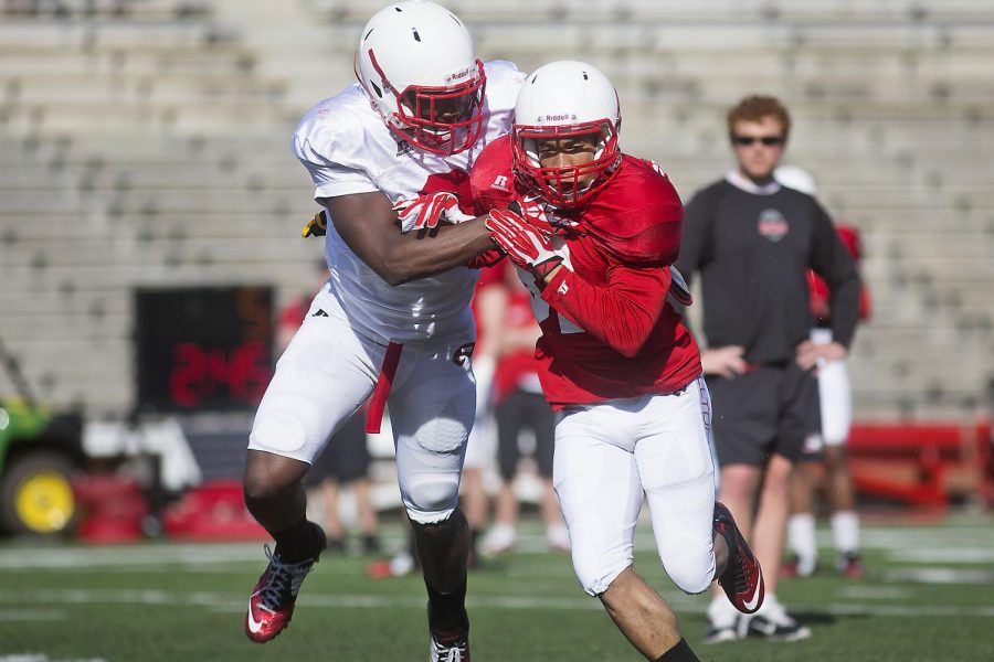 WKU junior defensive back Marcus Ward (L) and redshirt sophomore wide receiver Kylen Towner (R) fight for position during a route running drill during the teams open practice Wednesday April 1, 2015 at L.T. Smith Stadium. (Luke Franke/Herald)