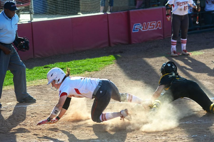 WKU junior Brook Holloway dodges the tag to score a run against USM. This was the third of six runs scored by the lady Hilltoppers during the second game of the double header played on April 11. The game ended with the lady Eagles being shut out 6-0. SPECIAL TO HERALD/ Andrew Livesay