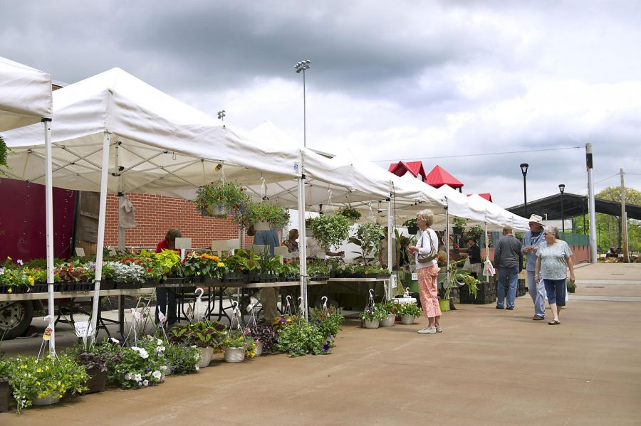 Vendors offered products to customers at the new SoKY Marketplace in Hot Rod Alley at the Bowling Green Ballpark on Saturday, April 25, 2015. The market is currently constructing a pavilion seen in the background with hopes to fill the building to its maximum capacity of 80 vendors. As of yet, only 24 vendors are set to sell their goods when the pavilion will open at the beginning of June. Nick Wagner/HERALD